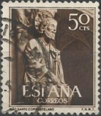 El Santiago del parteluz se sienta en silla de tijeras apoyada en leones. Con su mano derecha agarra una cartela en la que, aludiendo a su predicación en Hispania, podía leerse: