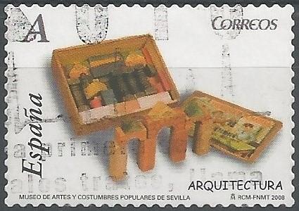 Juego de arquitectura fabricado en España hacia 1930: Conjunto de bloques de madera, de distintas formas y tamaños, y variados colores. Las piezas se recogen en una caja, en cuya tapa aparece la ilustración de unos niños jugando con el juego. (Museo de Artes y Costumbres Populares de Sevilla: DJ6014)
